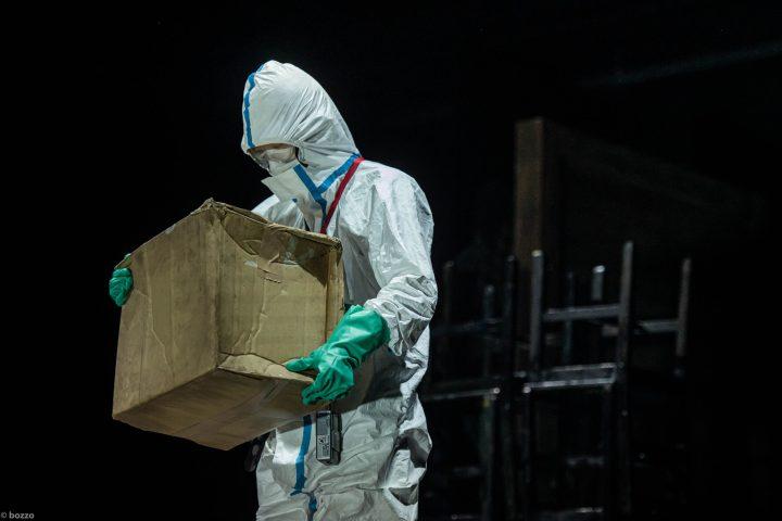 """Stage photo of """"Fukushima Trilogy #1 - Midnight Sunrise"""" wearing protective clothing"""