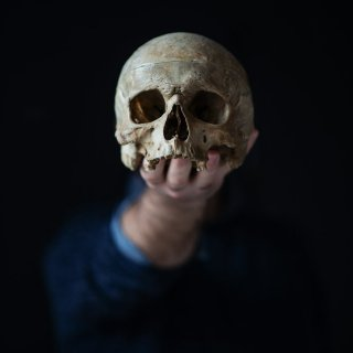holding a skull in his hand