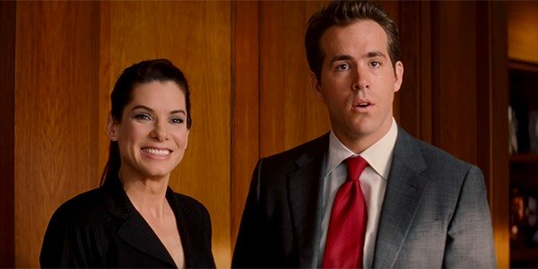 "Sandra Bullock, left, and Ryan Reynolds, right, star in the 2009 romantic comedy film ""The Proposal"". (Courtesy of Cinema Blend)"