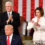 House Speaker Nancy Pelosi, right, rips a copy of Trump's speech after Trump delivers his State of the Union address. (Courtesy of USA Today)