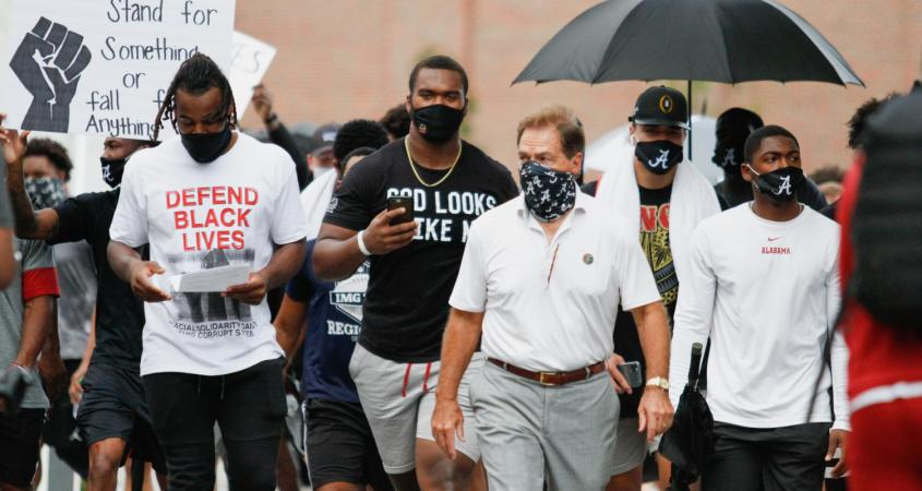 Nick Saban participates in a Black Lives Matter march with several other Alabama student-athletes on Aug. 31. (Keely Brewer/The Crimson White)