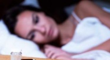 A Woman facing sleeping problem and looking the drugs.