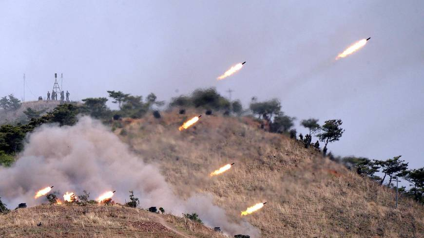 Hair-trigger: The Korean People's Army conducts a military drill in North Korea in this undated photo released Tuesday.