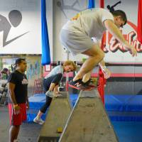 The rail thing: Participants in an Urban Evolutions parkour class climb and jump over obstacles. | THE WASHINGTON POST