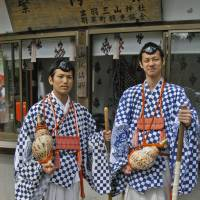 Happy to be shot,these yamabushi in their distinctive garb were idling in the summit car park. | CHRIS BAMFORTH PHOTO
