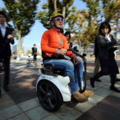Wheelchair Japan Kids Chair With Umbrella Segway Begins Trials On Japanese Streets The