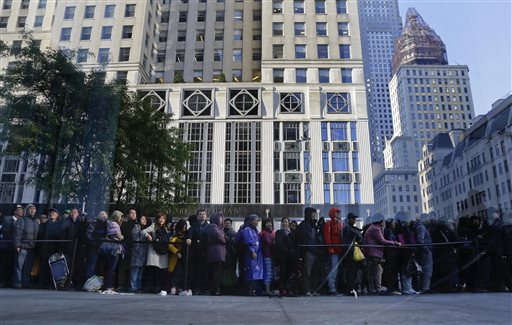 I was spared from waiting in a line like this one at the Fifth Avenue Apple Store. (AP Photo/Julie Jacobson)