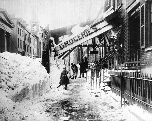 "The awning of a grocery store is damaged from the weight of the snow during the blizzard of 1888 in New York City.  The blizzard on March 12-14 paralyzed the city with about 40"" of snow and winds that reached up to 60 miles per hour, creating drifts as high as fifty feet.  (AP Photo)"
