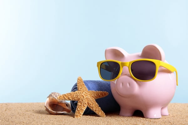 women and retirement planning+piggy w sunglasses