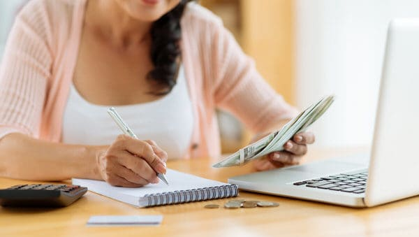 retirement planning in midlife+woman-notepad-computer