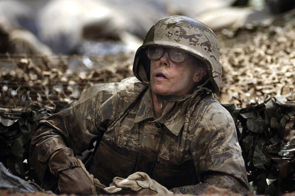 female vets with PTSD+female-soldier-in-mud
