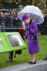 The Queen views a plaque in Jubilee Gardens in South Bank London