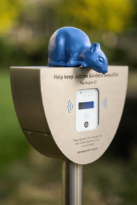 Blue squirrel sculpture sitting on contactless donation point in Jubilee Gardens