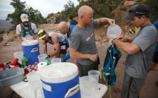 Steve Hooper, the owner of the St. George Running Center helps ultra marathon particpants fuels up at an aid station along the Flying Monkey Trail above Virgin early Friday, April 8, 2016 during the Zion 100 ultra marathon trail race. Runners competing in the 100K and 100 mile distances left the starting line Friday morning while runners competing in 55K and half-marathon distances will start Saturday morning. Despite a high probability of rain over the weekend, nearly 300 runners took of from the starting line Friday morning and more than another 200 were expected to run Saturday.