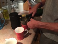 Martin uses flour sifter to strain cork out of his coffee and brandy.