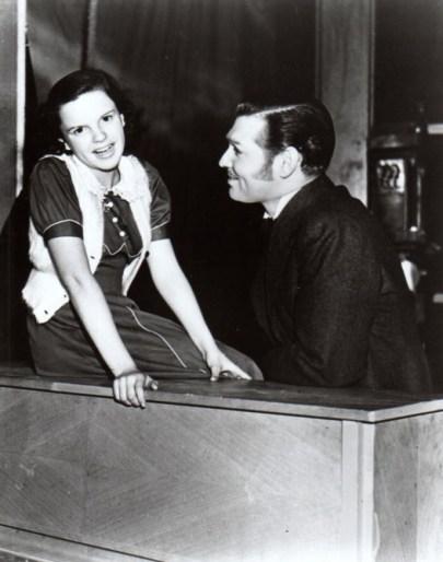 "Clark Gable congratulates Judy Garland after she sang ""(Dear Mr. Gable) You Made Me Love You"" at his studio birthday part"