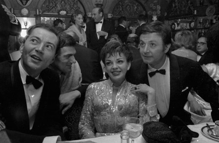 Writer Lionel Bart and actors Judy Garland and Kenneth Haigh attending the 'Maggie May Party', 1964. (Photo by Express/Getty Images)