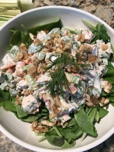 Serve over a bed of greens and top with chopped walnuts.