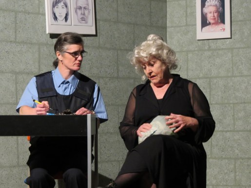 H.B. Hackett (aka Honeybunch played by Michele Gerard) brings Esmerelda Quipp (her friends call her Essie) into the station for questioning.