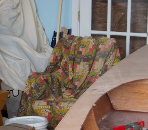 My rocker covered in a 1970s throw which came with my sailboat and a 5 gallon pail for a foot-stool ensures that I will never let fatigue get the better of me again.