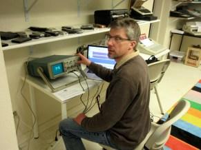 Chris experiments with an oscilloscope.