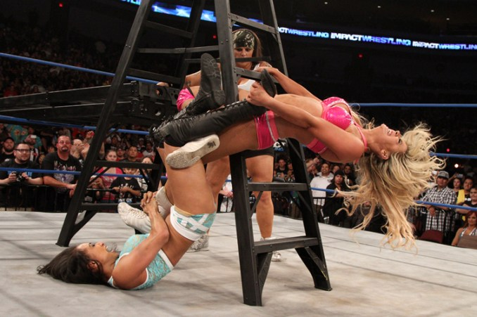 Gail Kim delivers a ladder-aided figure four to Taryn Terrell