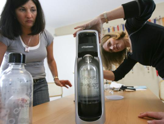 Joanne Domeniconi (left) and Jeanne Connon tested a SodaStream product for the Daily Grommet. (Aram Boghosian for The Boston Globe)