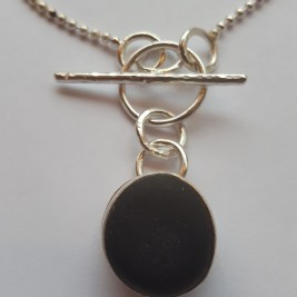 Black pebble toggle front necklace Choose a pebble and I can set in Silver for you and make into a necklace!