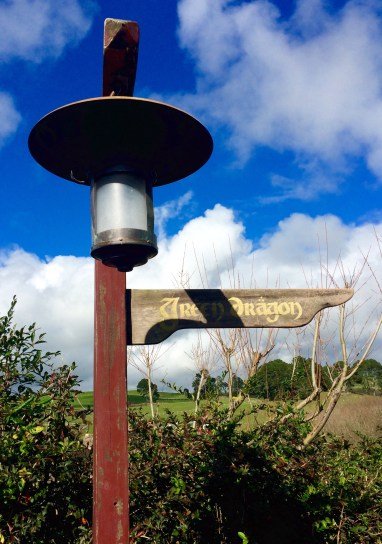 Sign post for the Green Dragon: beer time!