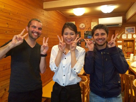 Verne and his cousin, Andre, pose for a picture 'Japanese' style, with the nicest barista in town!