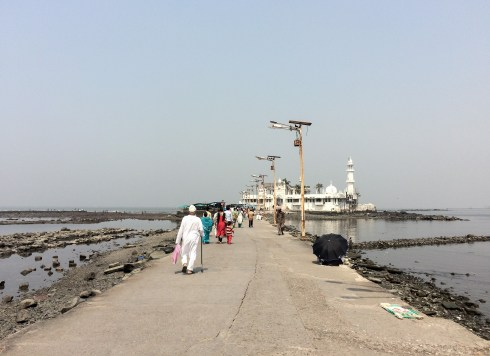 The Haji Ali Dargah mosque is accessible through a natural causeway that may flood during high tide