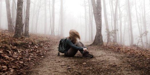Girl alone in woods