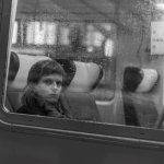 Girl looking out train window
