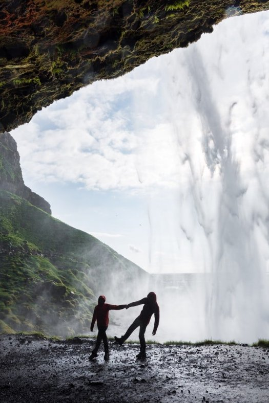 Couple behind waterfall