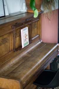 Upright piano with music