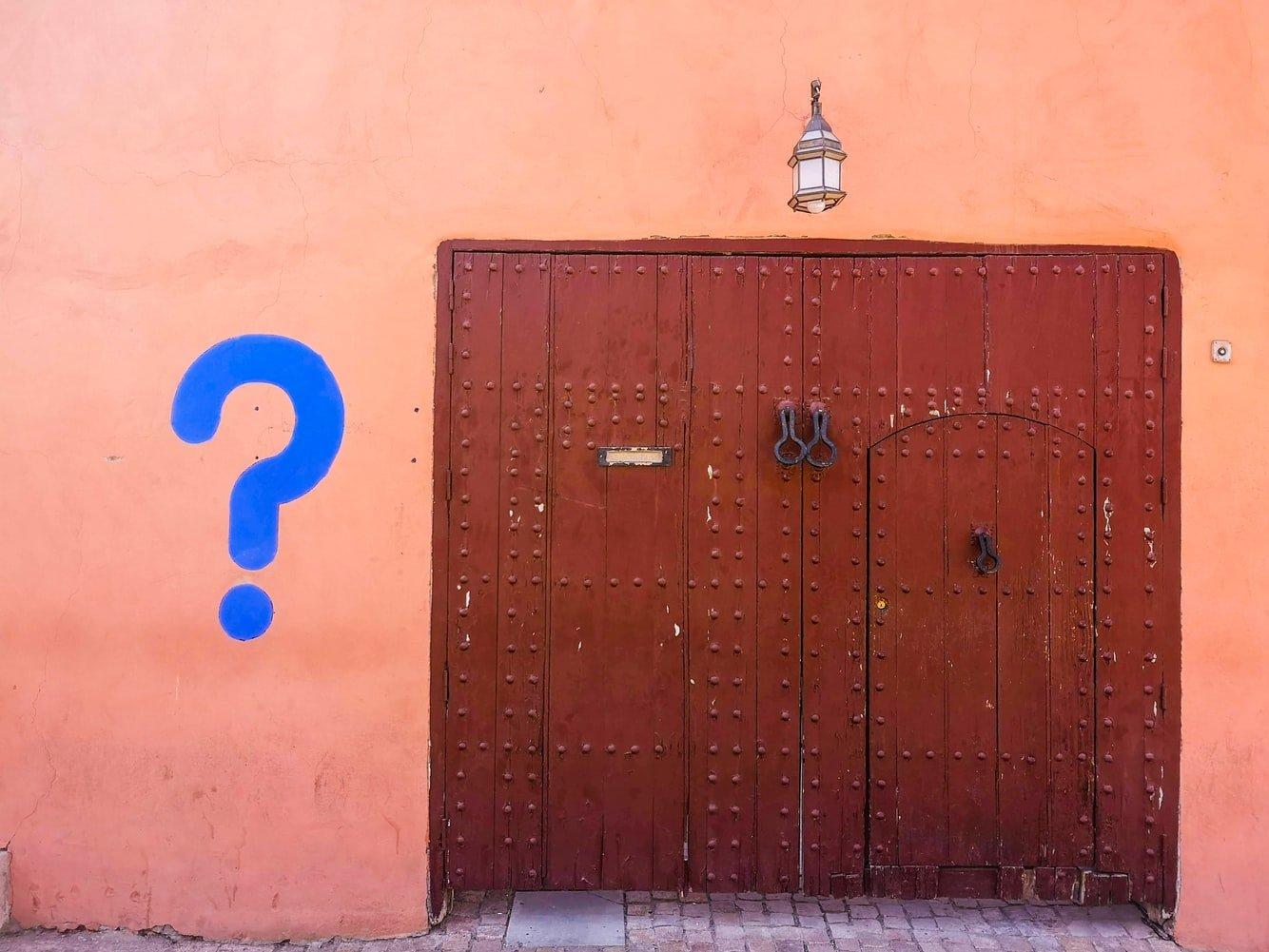Question mark by doorway
