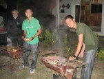 Ma Fuung and Ma Fie pitch in grilling help.