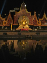 A reflection of the Buddha casted onto the canal water below.