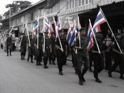 The ROTC school members hold their Thai flag high and proud.