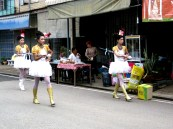 Students in costume parade through our small village.