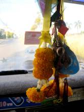 Flowers are hung from vehicles rear view mirrors to protect and show Buddhist respect.
