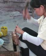 A Female Artisan Doing Copper Work