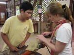 My Mother Speaking with a Cambodian Artisan Who Carves Wood and Stone Statues