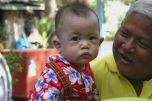 A Brand New Extended Family Member Rocks a Flowered Shirt and Joins the Songkran Festivities