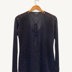 metallic blouse in black with front necktie and long-sleeves with scoop cut neck, on a hanger.