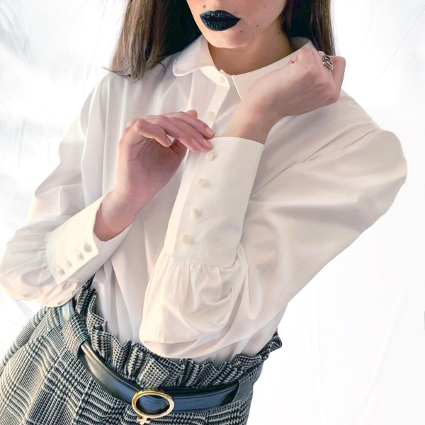 cotton blouse with puffed sleeves and jacquard shorts worn by model wearing black lipstick.