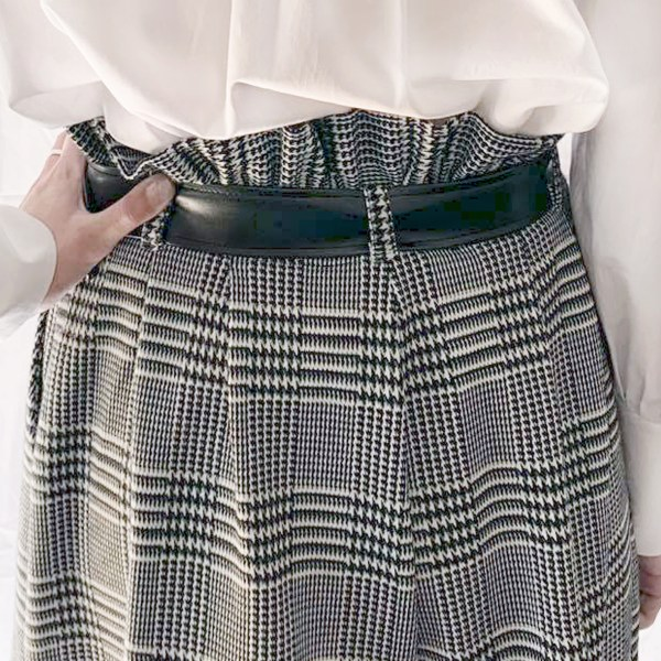 Best womens jacquard shorts back view plaid pattern. White blouse with puffed sleeves and hand on hip.