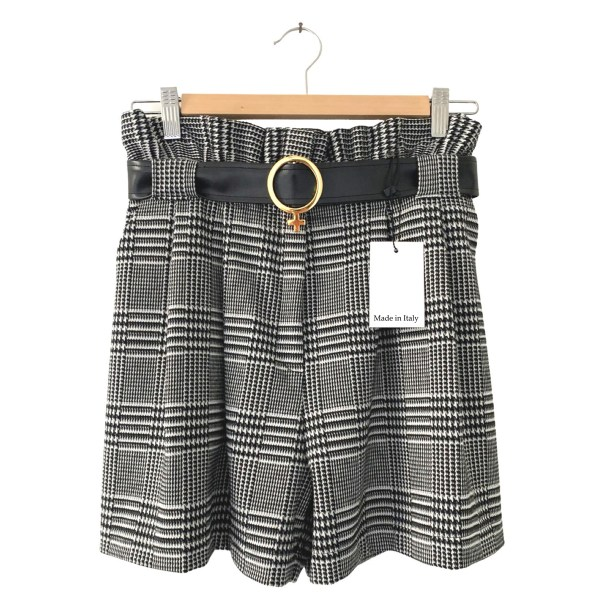 Women's jacquard shorts made with100% jacquard fabric black and white plaid style with buckle loops holding a Venus shaped black vinyl belt. Tag on plaid shorts says 'Made in Italy'