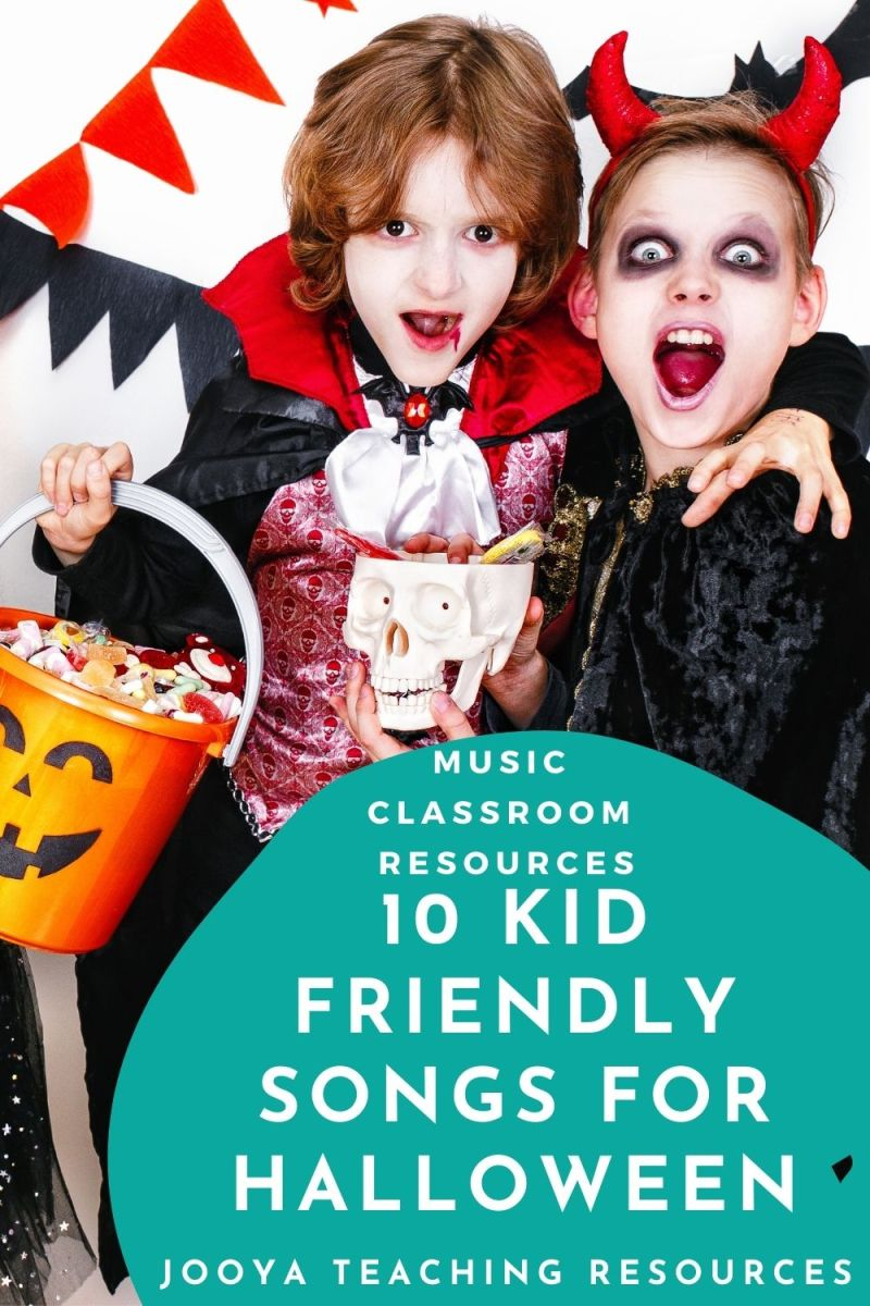 2 boys dressed in Halloween costumes, one is Dracual and he is holding is holding a bicket of candy and the other is a Devial and he has a skull full of candy