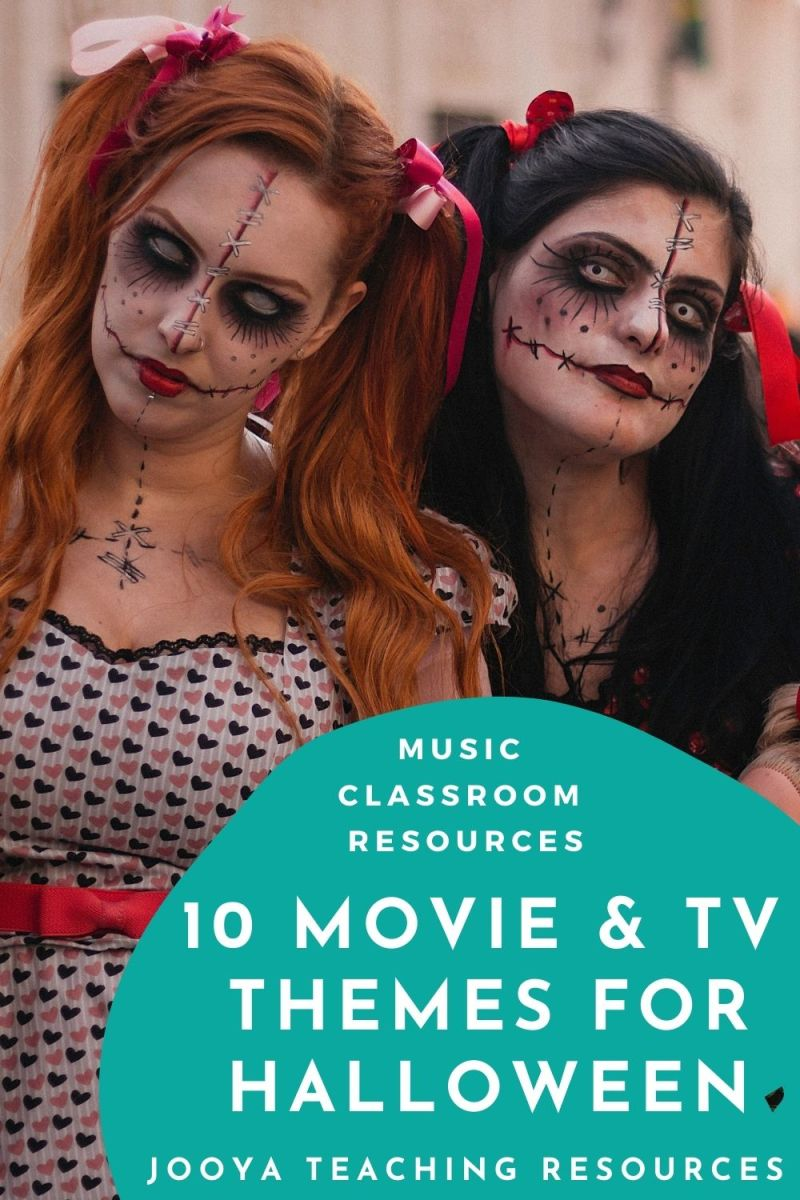 2 young women in Halloween costumes and scary makeup staring into the camera
